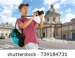 young tourist taking photo... | Shutterstock . vector #739184731