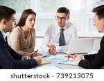 businesspeople discuss a new... | Shutterstock . vector #739213075