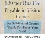 Small photo of sign that says bus fee, visitor center, and enjoy your visit