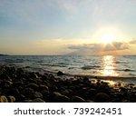 Sunset at peaceful rock beach...
