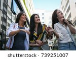 women walking city street.  | Shutterstock . vector #739251007
