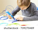 focused child with 3d printing... | Shutterstock . vector #739270489