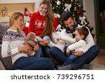 male child with parents having... | Shutterstock . vector #739296751