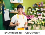 cropped image of asian male... | Shutterstock . vector #739299094