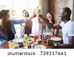 group of young people gathered... | Shutterstock . vector #739317661