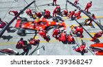 Small photo of SEPANG, MALAYSIA : SEPTEMBER 30, 2017 : Team members of Kimi Raikkonen of Scuderia Ferrari practice a pit stop ahead of the Malaysia Formula One (F1) Grand Prix at Sepang International Circuit (SIC).