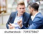 two handsome businessmen... | Shutterstock . vector #739375867