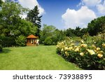 Stock photo beautiful garden with blooming roses and a small gazebo 73938895