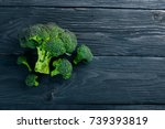 broccoli. on a wooden... | Shutterstock . vector #739393819