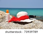 Hat and sunglasses on the rock. Phuket island, Thailand - stock photo