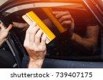 master installs tint film for...   Shutterstock . vector #739407175