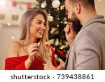 people sharing christmas wafer... | Shutterstock . vector #739438861