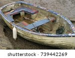 Old And Dirty Sunken Row Boat...