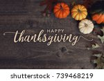 Small photo of Happy Thanksgiving text with pumpkins and leaves over dark wood background