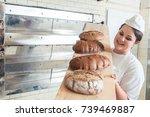 baker woman presenting bread on ... | Shutterstock . vector #739469887