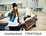 young woman holding keys to new ... | Shutterstock . vector #739474264
