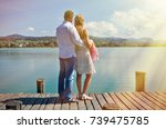 a couple on the wooden jetty at ... | Shutterstock . vector #739475785