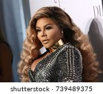 Small photo of NEW YORK - SEP 14, 2017: Lil' Kim attends the 3rd annual Diamond Ball at Cipriani on September 14, 2017, in New York City.