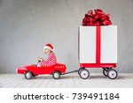happy child with christmas gift.... | Shutterstock . vector #739491184