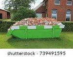 loaded dumpster near a... | Shutterstock . vector #739491595