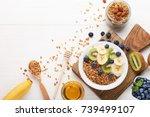 tasty granola with berries in... | Shutterstock . vector #739499107