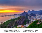 Small photo of Sunset view of Copacabana and Botafogo in Rio de Janeiro. Brazil. Night cityscape of Rio de Janeiro