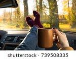 autumn car trip. woman in warm... | Shutterstock . vector #739508335
