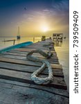 rope laying on dock overlooking ... | Shutterstock . vector #739509409