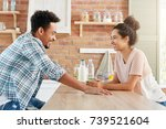 young couple or family sit... | Shutterstock . vector #739521604