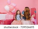 smiling young woman in denim... | Shutterstock . vector #739526695