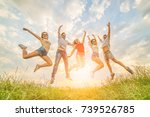 the happy friends jumping on... | Shutterstock . vector #739526785