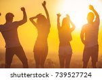 the four people dancing on the... | Shutterstock . vector #739527724