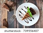 slice of chocolate cheesecake... | Shutterstock . vector #739556407