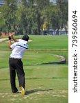 golfer in tee shot action on... | Shutterstock . vector #739560694