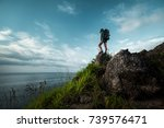 lady hiker with backpack... | Shutterstock . vector #739576471