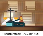 tax law books on a table and... | Shutterstock .eps vector #739584715