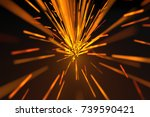 yellow sparks on background | Shutterstock . vector #739590421
