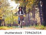 happy active woman riding bike... | Shutterstock . vector #739626514