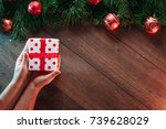 a frame of pine branches and... | Shutterstock . vector #739628029