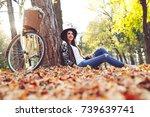 young girl in autumn scenery.... | Shutterstock . vector #739639741
