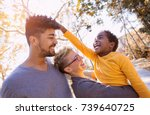 happy young mixed race couple... | Shutterstock . vector #739640725