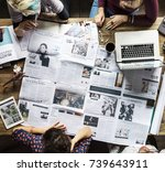 colleagues discussing newspaper ... | Shutterstock . vector #739643911