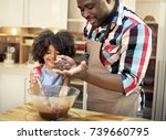 family baking together in the... | Shutterstock . vector #739660795