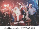 A Man Dressed As Santa Claus...