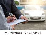 insurance agent examine damaged ... | Shutterstock . vector #739673524