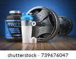 barbell and whey protein shaker.... | Shutterstock . vector #739676047
