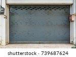 old rusty gray roller shutter... | Shutterstock . vector #739687624