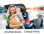 young mother with baby boy in... | Shutterstock . vector #739697995