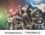 young people at the new year... | Shutterstock . vector #739698415