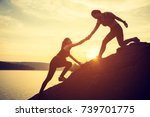 hikers climbing on rock ... | Shutterstock . vector #739701775